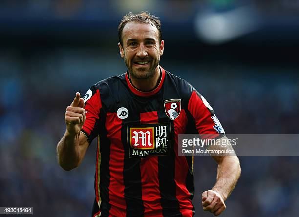 Glenn Murray of Bournemouth celebrates scoring his team's first goal during the Barclays Premier League match between Manchester City and AFC...