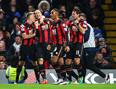 Glenn Murray of Bournemouth celebrates scoring his team's first goal with his team mates during the Barclays Premier League match between Chelsea and...