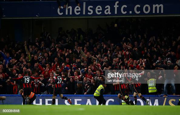 Glenn Murray of Bournemouth celebrates scoring his team's first goal with his team mates in front of their supporters during the Barclays Premier...