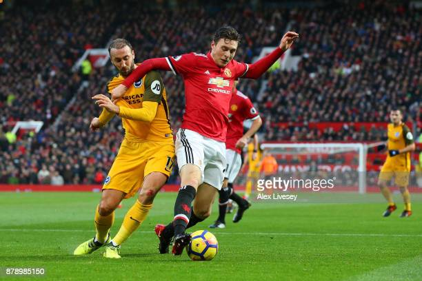Glenn Murray of Brighton and Hove Albion and Victor Lindelof of Manchester United battle for the ball during the Premier League match between...