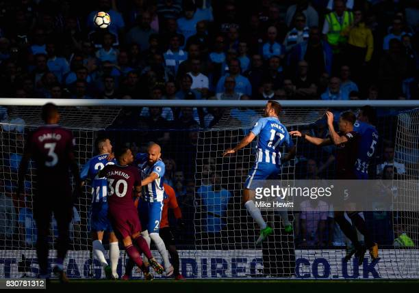 Glenn Murray of Brighton and Hove Albion attempts to head towards goal during the Premier League match between Brighton and Hove Albion and...