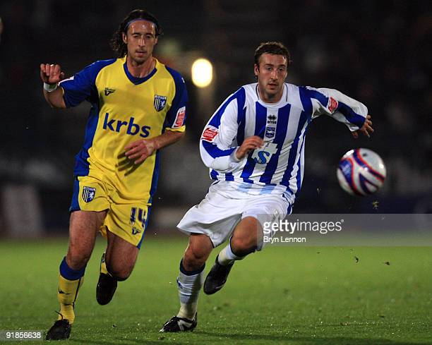 Glenn Murray of Brighton and Hove Albion avoids Adam Miller of Gillingham during the CocaCola League One match between Brighton Hove Albion and...