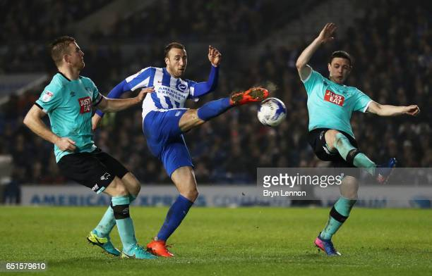 Glenn Murray of Brighton and Hove Albion battles with Chris Baird and Alex Pearce of Derby County during the Sky Bet Championship match between...