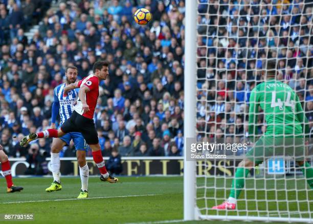 Glenn Murray of Brighton and Hove Albion beats Cedric Soares of Southampton scores their first goal during the Premier League match between Brighton...