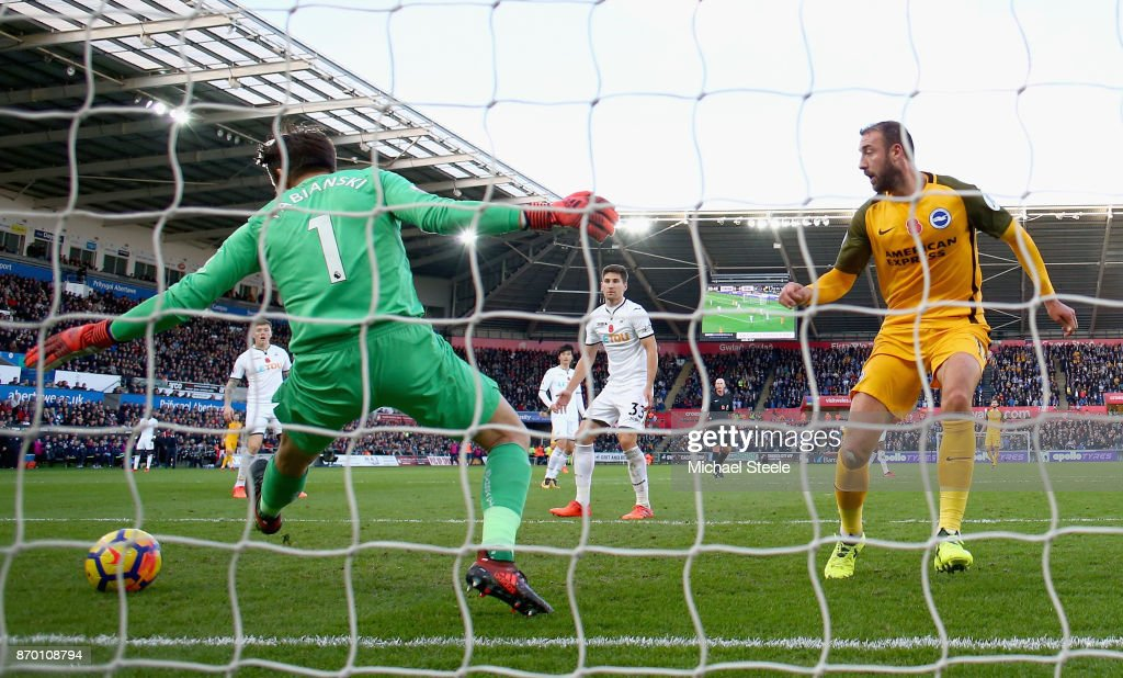 Glenn Murray of Brighton and Hove Albion beats Lukasz Fabianski of Swansea City as he scores his side's first goal during the Premier League match between Swansea City and Brighton and Hove Albion at Liberty Stadium on November 4, 2017 in Swansea, Wales.