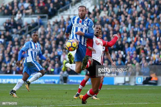 Glenn Murray of Brighton and Hove Albion beats Virgil van Dijk of Southampton to the ball during the Premier League match between Brighton and Hove...