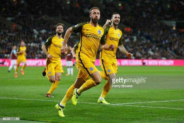 Glenn Murray of Brighton and Hove Albion celebrates as he scores their first goal during the Premier League match between West Ham United and...