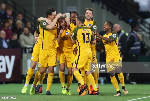 Glenn Murray of Brighton and Hove Albion celebrates as he scores their first goal with team mates during the Premier League match between West Ham...