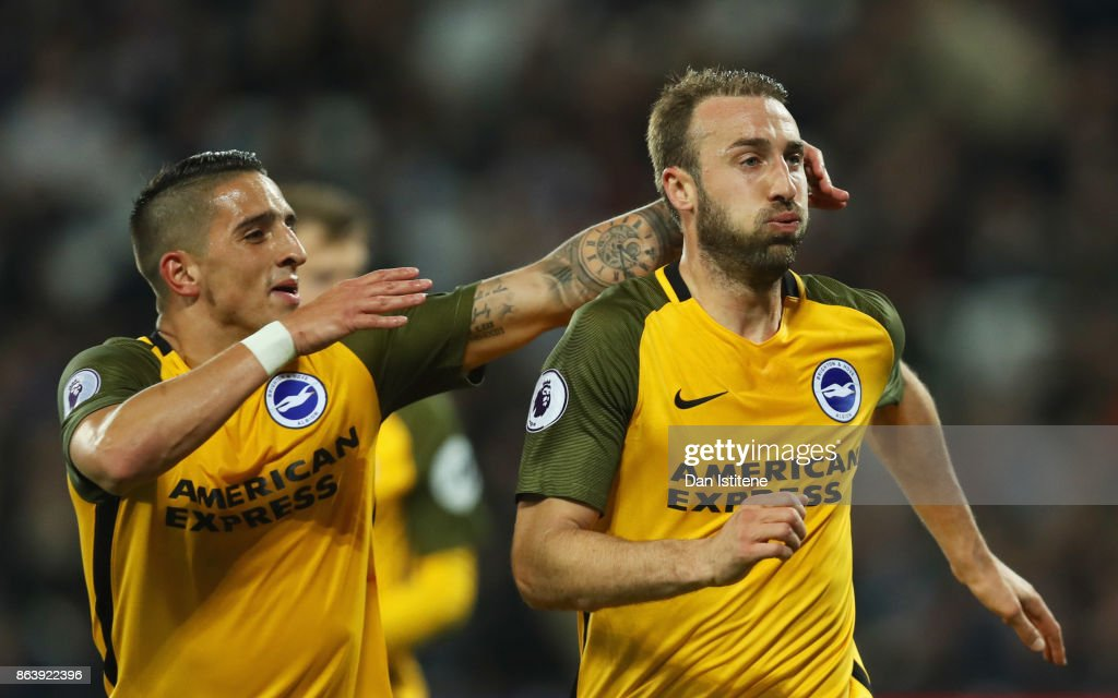 Glenn Murray of Brighton and Hove Albion (R) celebrates as he scores their third goal from the penalty spot with team mate Anthony Knockaert during the Premier League match between West Ham United and Brighton and Hove Albion at London Stadium on October 20, 2017 in London, England.
