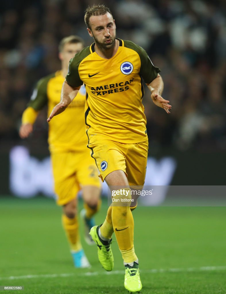 Glenn Murray of Brighton and Hove Albion celebrates as he scores their third goal from the penalty spot during the Premier League match between West Ham United and Brighton and Hove Albion at London Stadium on October 20, 2017 in London, England.