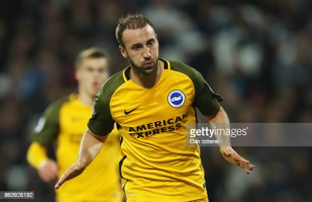 Glenn Murray of Brighton and Hove Albion celebrates as he scores their third goal from the penalty spot during the Premier League match between West...