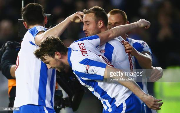 Glenn Murray of Brighton and Hove Albion celebrates as he with team mates as he scores their first goal from a penalty during the Sky Bet...