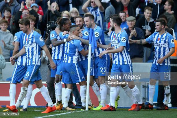 Glenn Murray of Brighton and Hove Albion celebrates with team mates as he scores their first goal during the Premier League match between Brighton...