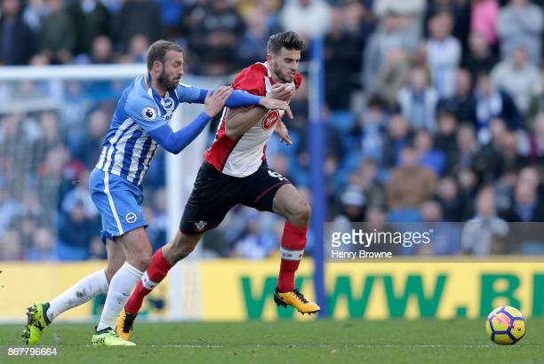 Glenn Murray of Brighton and Hove Albion challenges Wesley Hoedt of Southampton during the Premier League match between Brighton and Hove Albion and...