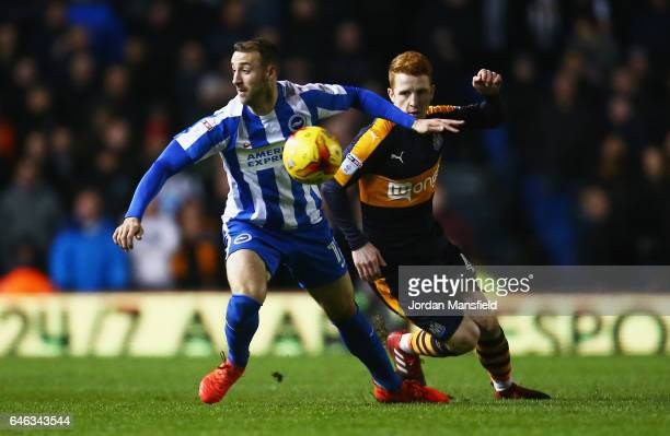 Glenn Murray of Brighton and Hove Albion evades Jack Colback of Newcastle United during the Sky Bet Championship match between Brighton Hove Albion...