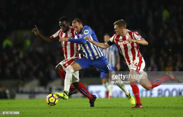 Glenn Murray of Brighton and Hove Albion holds off Mame Biram Diouf of Stoke City and Darren Fletcher of Stoke City during the Premier League match...
