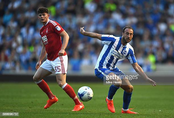 Glenn Murray of Brighton and Hove Albion in action as Oliver Burke of Nottingham Forest looks on during the Sky Bet Championship match between...