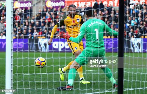 Glenn Murray of Brighton and Hove Albion scores his side's first goal during the Premier League match between Swansea City and Brighton and Hove...
