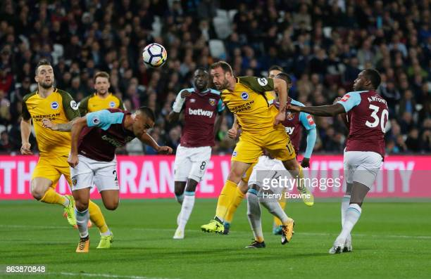 Glenn Murray of Brighton and Hove Albion scores their first goal during the Premier League match between West Ham United and Brighton and Hove Albion...