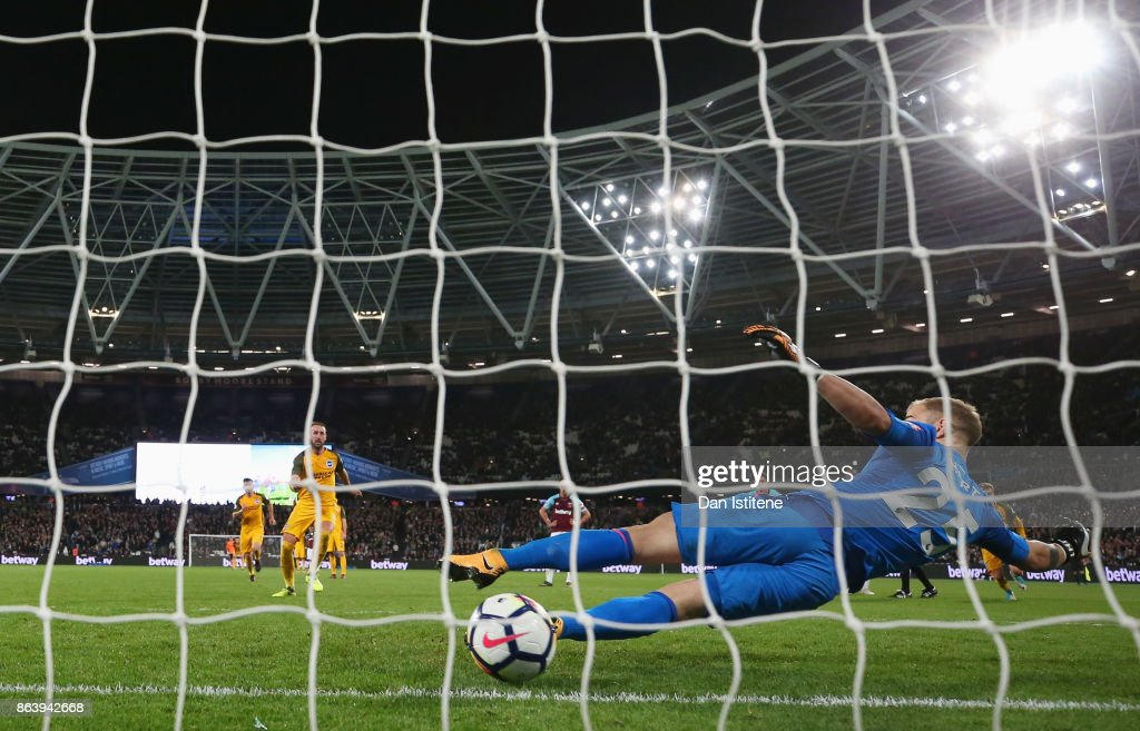 Glenn Murray of Brighton and Hove Albion scores their third goal from the penalty spot past goalkeeper Joe Hart of West Ham United during the Premier League match between West Ham United and Brighton and Hove Albion at London Stadium on October 20, 2017 in London, England.