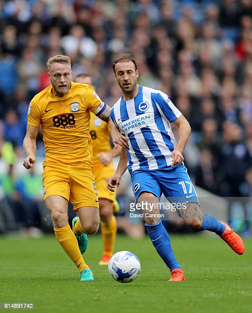 Glenn Murray of Brighton and Hove Albion with Tom Clarke of Preston North End during the Sky Bet Championship match between Brighton Hove Albion and...