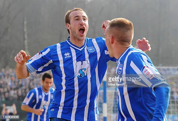 Glenn Murray of Brighton celebrates after scoring with team mate Craig Noone during the npower League One match between Brighton Hove Albion and...