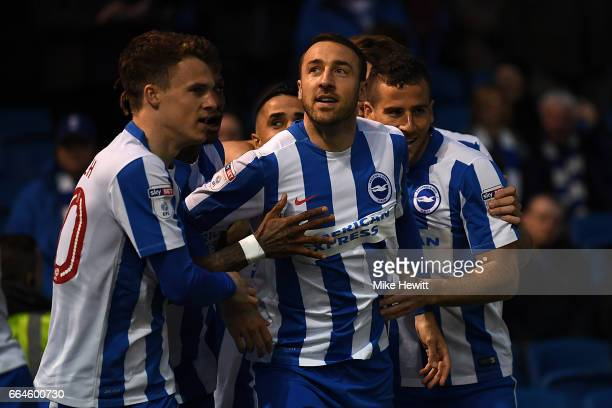 Glenn Murray of Brighton celebrates with team mates after opening the scoring during the Sky Bet Championship match between Brighton Hove Albion and...