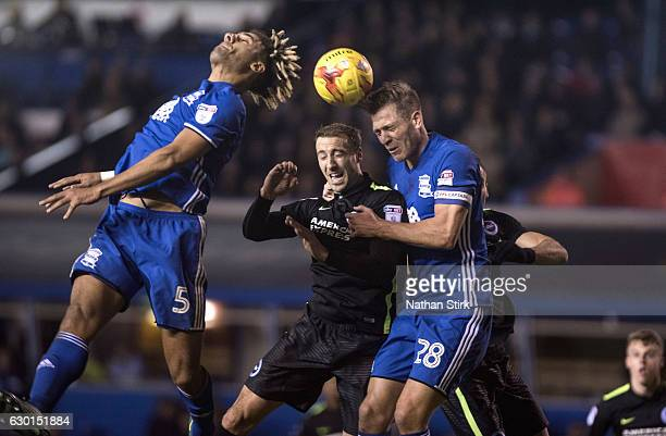 Glenn Murray of Brighton Hove Albion battles for the ball with Ryan Shotton and Michael Morrison of Birmingham City in action during the Sky Bet...