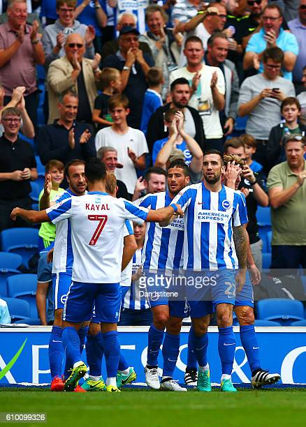 Glenn Murray of Brighton Hove Albion celebrates with teammates after scoring the opening goal during the Sky Bet Championship match between Brighton...