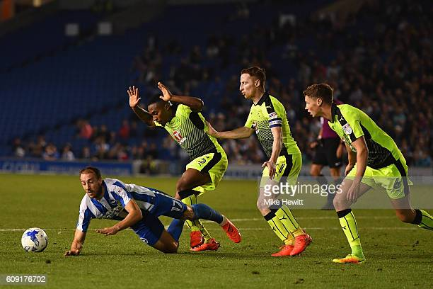 Glenn Murray of Brighton Hove Albion fails to win a penalty after falling in the penalty area during the EFL Cup Third Round match between Brighton...