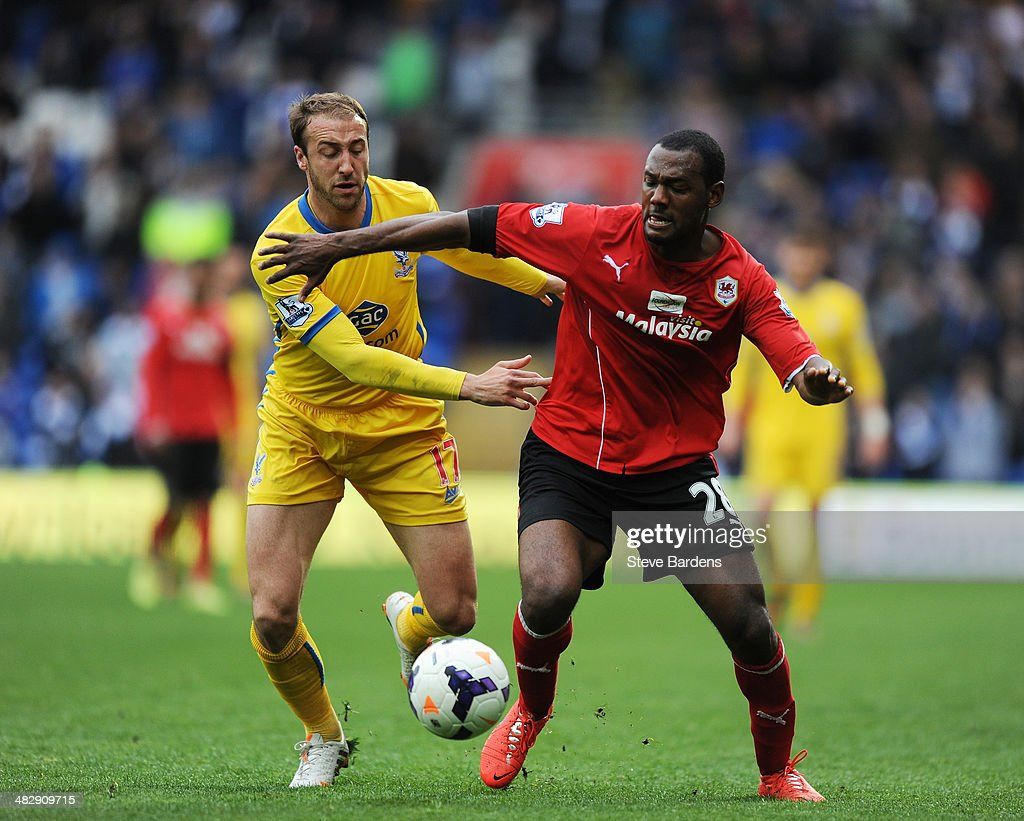 <a gi-track='captionPersonalityLinkClicked' href=/galleries/search?phrase=Glenn+Murray+-+Soccer+Player&family=editorial&specificpeople=15203667 ng-click='$event.stopPropagation()'>Glenn Murray</a> of Crystal Palace and Kevin Theophile Catherine of Cardiff battle for the ball during the Barclays Premier League match between Cardiff City and Crystal Palace at Cardiff City Stadium on April 5, 2014 in Cardiff, Wales.