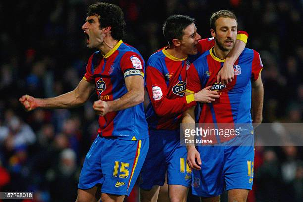 Glenn Murray of Crystal Palace celebrates with teammates Mile Jedinak and Owen Garvan after scoring from the penalty spot during the npower...