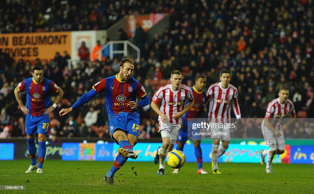 <a gi-track='captionPersonalityLinkClicked' href=/galleries/search?phrase=Glenn+Murray+-+Soccer+Player&family=editorial&specificpeople=15203667 ng-click='$event.stopPropagation()'>Glenn Murray</a> of Crystal Palace scores the equalising goal during the FA Cup with Budweiser Third Round replay match between Stoke City and Crystal Palace at Britannia Stadium on January 15, 2013 in Stoke on Trent, England.