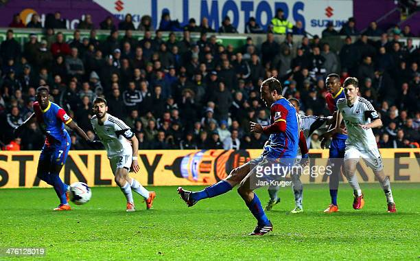 Glenn Murray of Crystal Palace scores their first goal from the penalty spot during the Barclays Premier League match between Swansea City and...