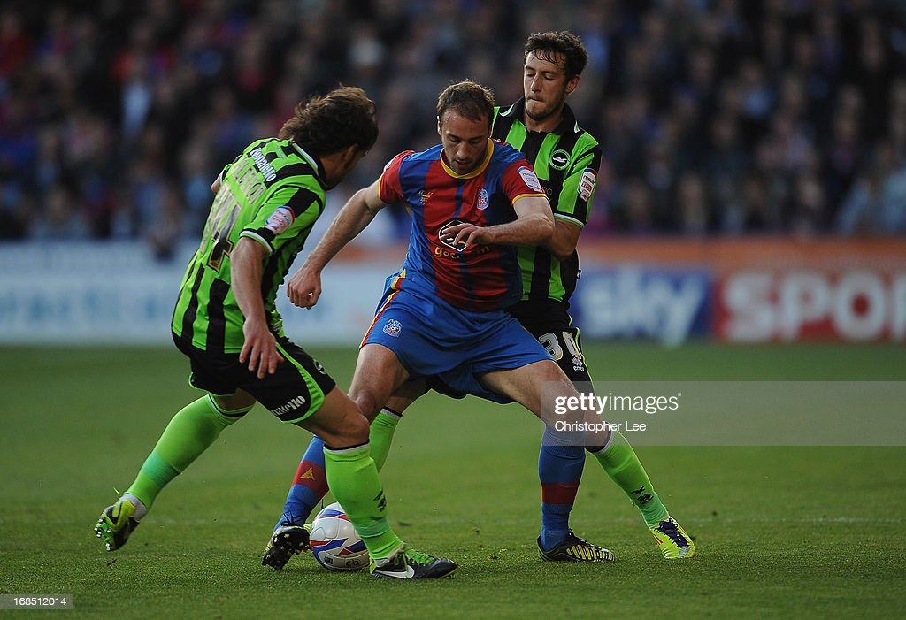 Glenn Murray of Palace battles with Inigo Calderon and Will Buckley of Brighton during the npower Championship Play Off Semi Final, First Leg at Selhurst Park on May 10, 2013 in London, England.