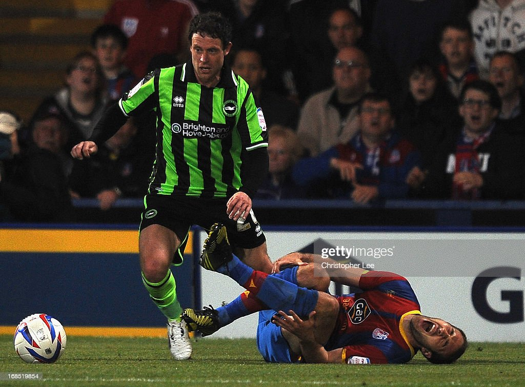 Glenn Murray of Palace goes down injured and is later taken off the field during the npower Championship Play Off Semi Final, First Leg at Selhurst Park on May 10, 2013 in London, England.