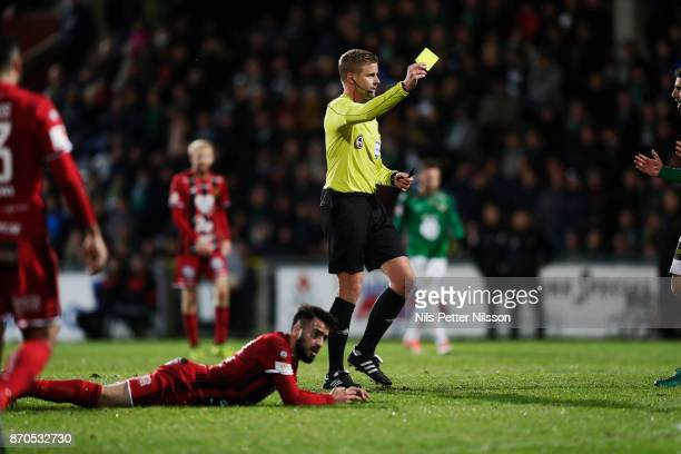 Glenn Nyberg referee shows a yellow card during the Allsvenskan match between Jonkopings Sodra IF and Ostersunds FK at Stadsparksvallen on November 5...