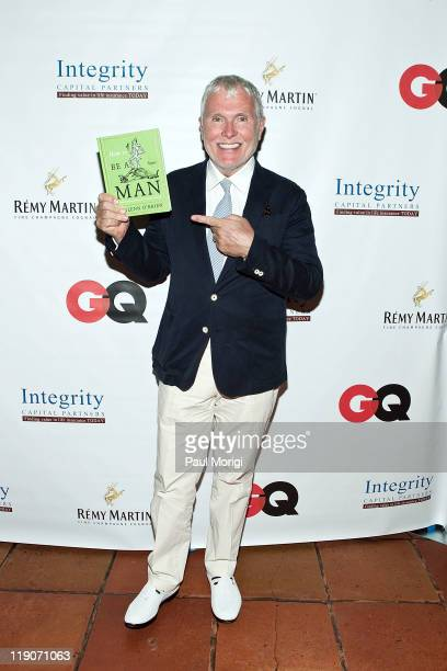 Glenn O'Brien poses with a copy of his book at the 'How to be a man A Guide to Style and Behavior for the Modern Gentleman' private reception at...