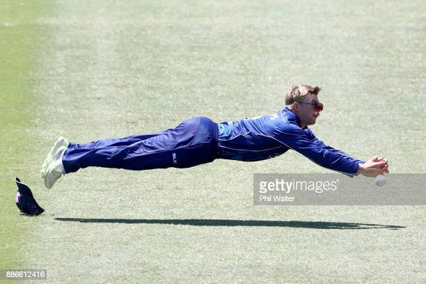 Glenn Phillips of Auckland misses out on a catch during the Ford Trophy match between Auckland and Canterbury at Eden Park on December 6 2017 in...