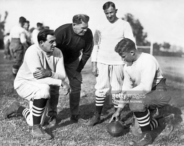Glenn 'Pop' Warner is the new football coach at Stanford University Stanford California November 1924 LR 'Tiny' Thornhill linesmen tutor Pop Warner...