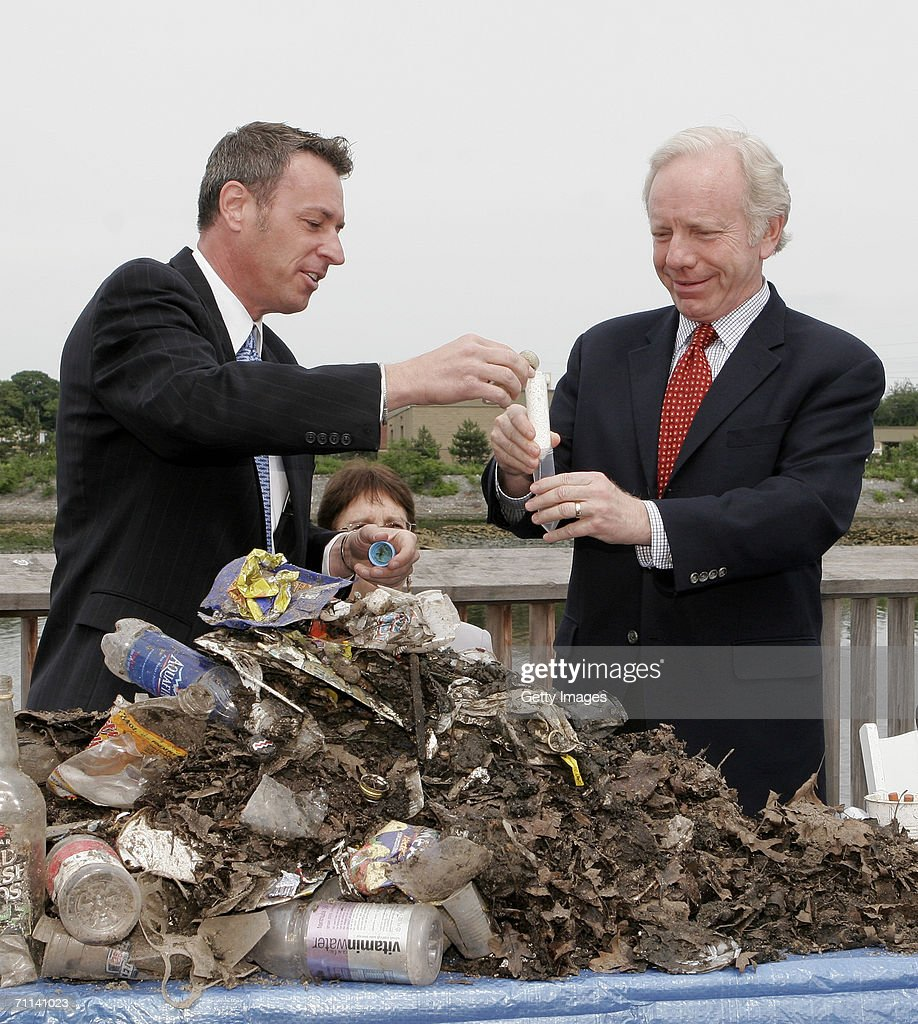 Glenn Rink, Founder and President of AbTech Industries, Inc., left, talks about a sample of polluted waste that was captured by Smart Sponge technology as he demonstrates the process with Sen. Joe Lieberman (D-CT) during a press conference at the Maritime Aquarium on June 5, 2006 in Norwalk, Connecticut. The Smart Sponge is a cost effective, non-toxic, non-leaching, fully recyclable filtration system that removes harmful petroleum substances like gasoline, oil & grease, sediment and debris, and kills bacteria such as E. coli and enterococcus on contact.