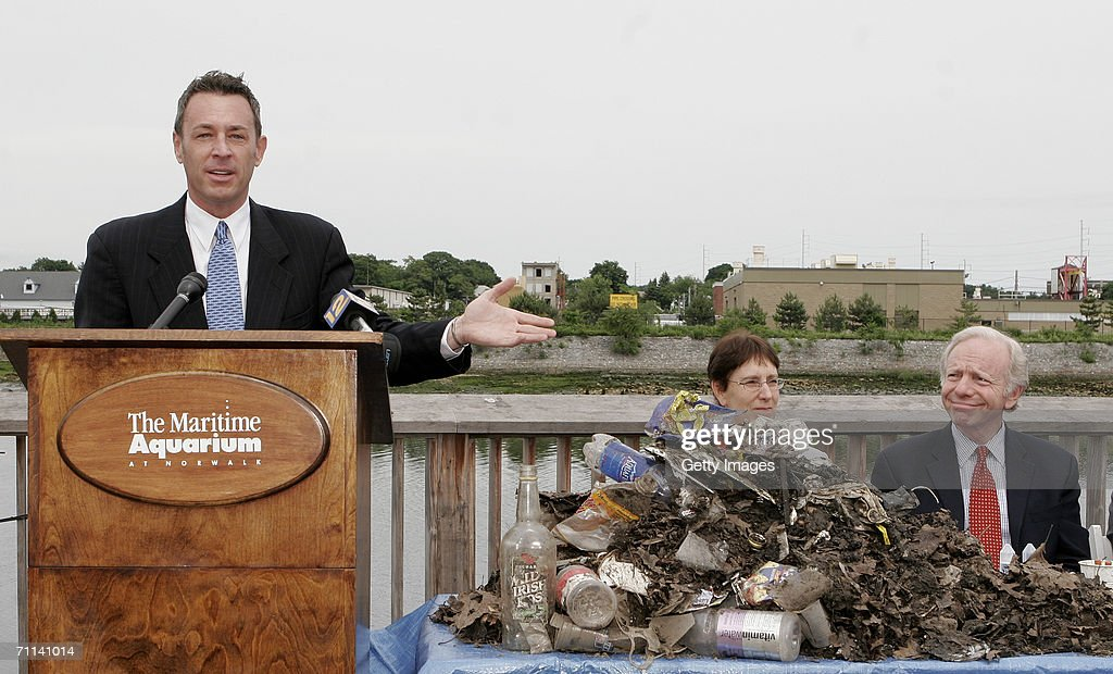 Glenn Rink, Founder and President of AbTech Industries, Inc. talks about a sample of polluted waste that was captured by Smart Sponge technology as U.S. Senator Joe Lieberman, far right, and Norwalk Maritime Aquarium President Jennifer Herring look on during a press conference at the Maritime Aquarium on June 5, 2006 in Norwalk, Connecticut.. The Smart Sponge is a cost effective, non-toxic, non-leaching, fully recyclable filtration system that removes harmful petroleum substances like gasoline, oil & grease, sediment and debris, and kills bacteria such as E. coli and enterococcus on contact.