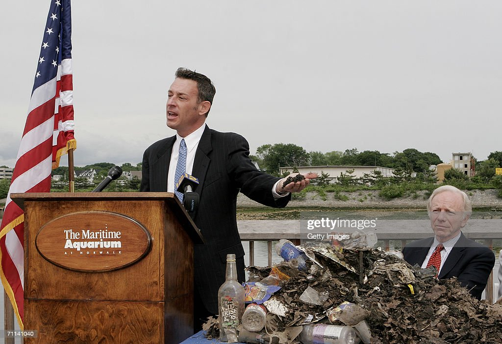 Glenn Rink, Founder and President of AbTech Industries, Inc. talks about a sample of polluted waste that was captured by Smart Sponge technology as U.S. Senator Joe Lieberman, right, looks on during a press conference at the Maritime Aquarium on June 5, 2006 in Norwalk, Connecticut. The Smart Sponge is a cost effective, non-toxic, non-leaching, fully recyclable filtration system that removes harmful petroleum substances like gasoline, oil & grease, sediment and debris, and kills bacteria such as E. coli and enterococcus on contact.