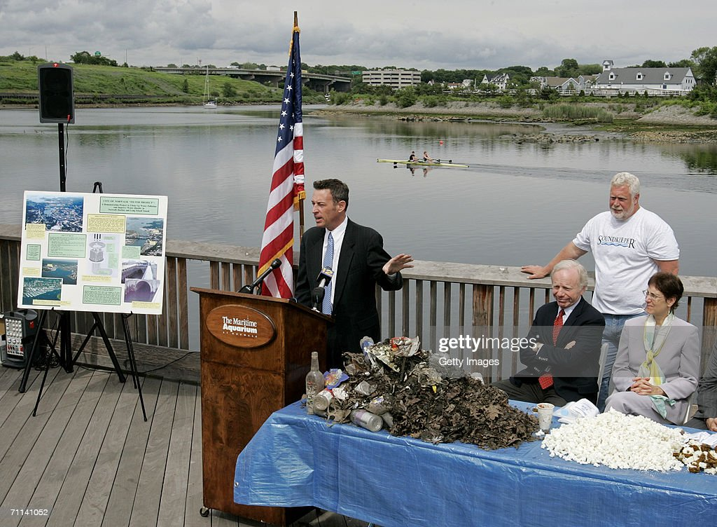 Glenn Rink, Founder and President of AbTech Industries, Inc. talks about a sample of polluted waste that was captured by Smart Sponge technology as U.S. Senator Joe Lieberman, Long Island Soundkeeper Terry Backer, and Jennifer Herring, President of the Maritime Aquarium at Norwalk look on during a press conference at the Maritime Aquarium on June 5, 2006 in Norwalk, Connecticut. The Smart Sponge is a cost effective, non-toxic, non-leaching, fully recyclable filtration system that removes harmful petroleum substances like gasoline, oil & grease, sediment and debris, and kills bacteria such as E. coli and enterococcus on contact.
