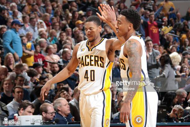Glenn Robinson III and Jeff Teague of the Indiana Pacers react during the game against the Utah Jazz on March 20 2017 at Bankers Life Fieldhouse in...