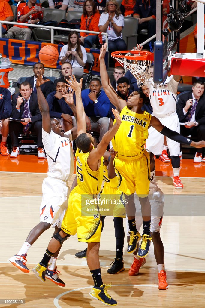 Glenn Robinson III #1 and Jon Horford #15 of the Michigan Wolverines defend the basket against Sam McLaurin #0 of the Illinois Fighting Illini during the game at Assembly Hall on January 27, 2013 in Champaign, Illinois. Michigan defeated Illinois 74-60.