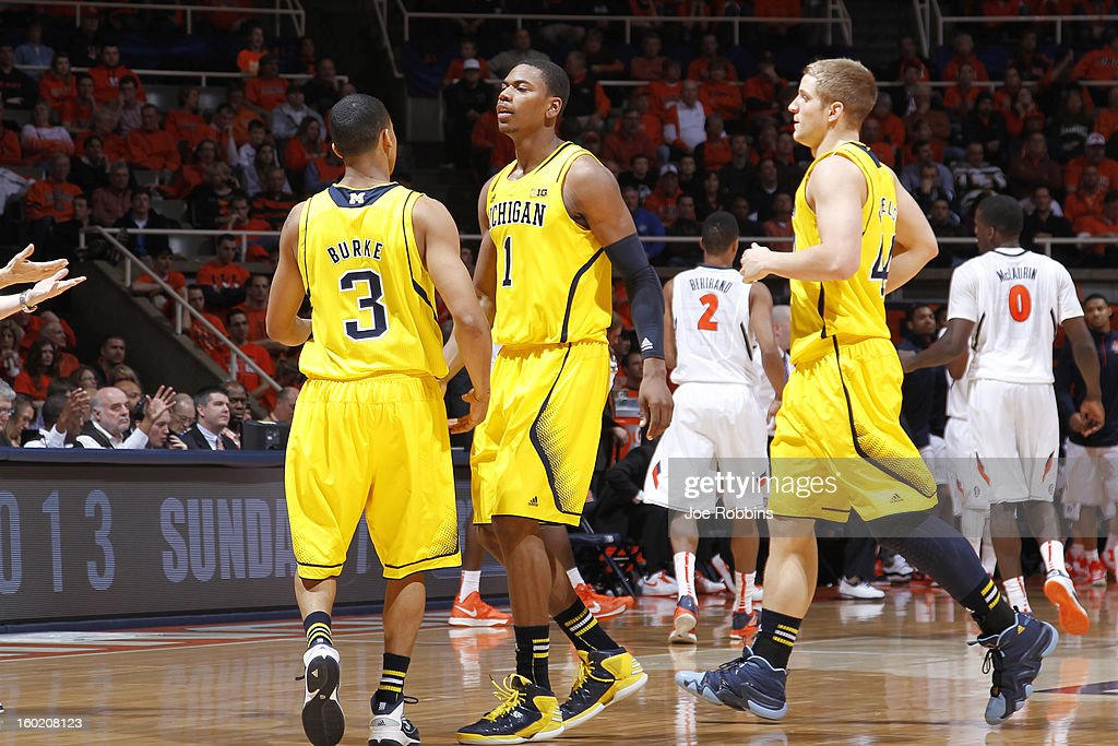 Glenn Robinson III #1 and Trey Burke #3 of the Michigan Wolverines celebrate against the Illinois Fighting Illini during the game at Assembly Hall on January 27, 2013 in Champaign, Illinois. Michigan defeated Illinois 74-60.