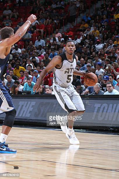 Glenn Robinson III looks to move the ball against the Dallas Mavericks during the game on July 18 2015 at Thomas And Mack Center Las Vegas Nevada...