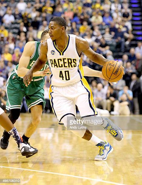 Glenn Robinson III of the Indiana Pacers dribbles the ball during the game against the Boston Celtics at Bankers Life Fieldhouse on November 4 2015...