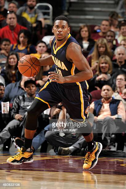 Glenn Robinson III of the Indiana Pacers drives to the basket against the Cleveland Cavaliers on October 15 2015 at Quicken Loans Arena in Cleveland...